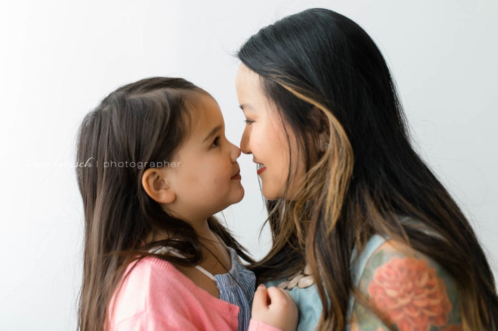 mother daughter portrait on white background asian