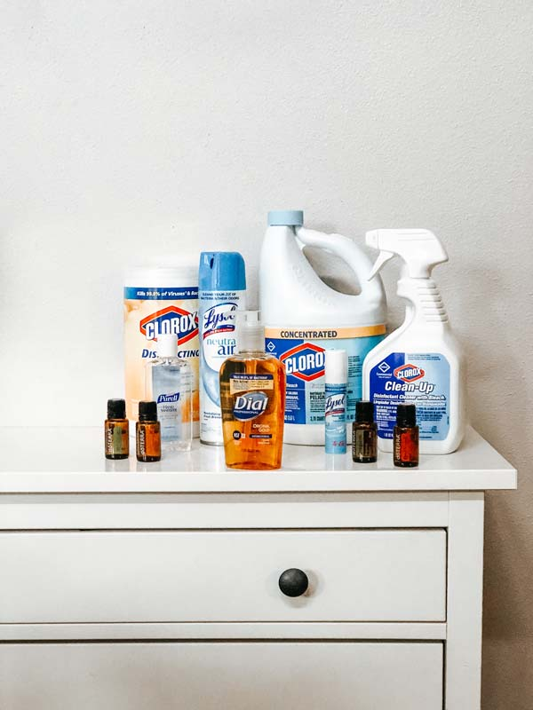 cleaning products on white dresser on white wall